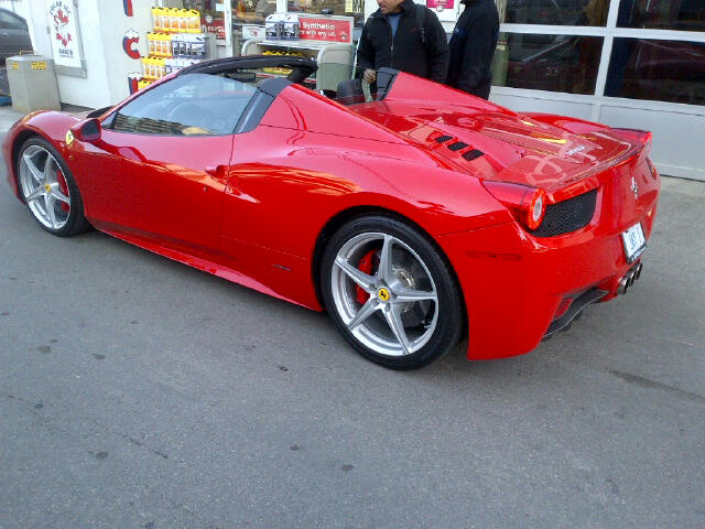 Red Ferrari driver's rear shot