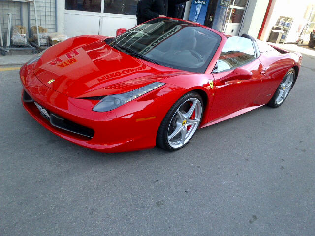Red Ferrari driver's side shot