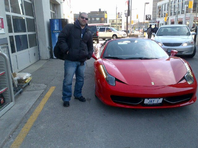Me posing beside red Ferrari
